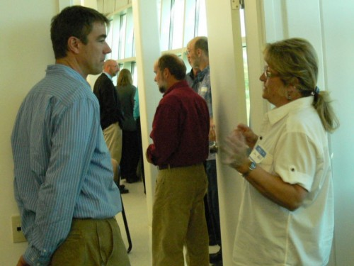 Paul Danicic (Friends of the Boundary Waters Wilderness) and Janice Hall (Cook County commissioner) share ideas between planning sessions at the kickoff meeting of the team planning the 2011 International Community Congress.
